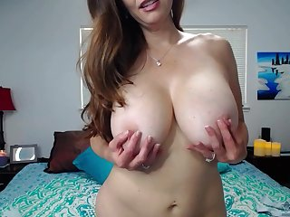 Busty MILF sits naked on live cam, ready to masturbate