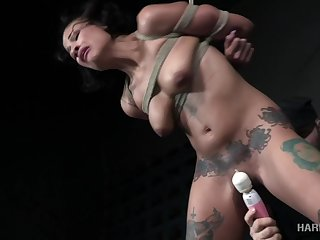 Captivating MILF gets a attraction of rope bondage and some pussy toying