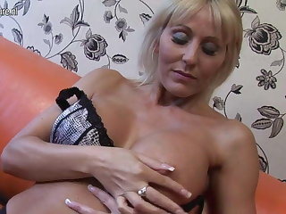 Hot British cougar mom playing with the brush pussy