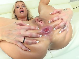 Dirty gripe Synthia penetrates her brass neck and ass with a big dildo