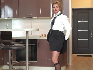 Bossy Russian chick Oliya is masturbating pussy in be passed on kitchen