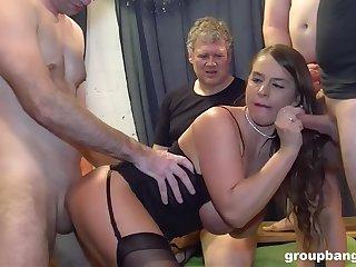 Lively sexpot experiences double-penetration at near rough gangbang