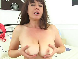Mature brunette took off her dress added to panties added to showed her hairy pussy to the camera