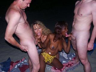 Lesbian ebony exhausting cock above beach